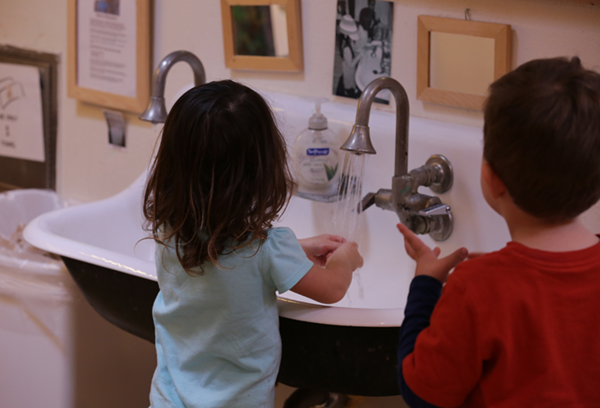 Children washing their hands